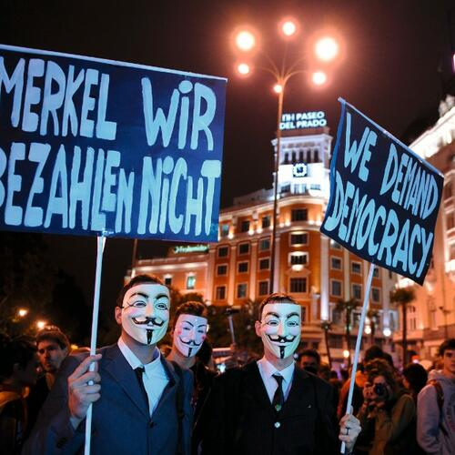 Anti-Merkel-Plakate in Madrid Quelle: Getty Images