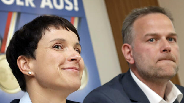 Frauke Petry, chairwoman of the German right-populist AfD (Alternative for Germany) party, left, and and Leif-Erik Holm, right, top candidate of the AfD in the German federal state of Mecklenburg-Western Pomerania, address the media during a press conference in Berlin, Germany, Monday, Sept. 5, 2016. The nationalist, anti-immigration party performed strongly in a state election Sunday in the region where German Chancellor Angela Merkel has her political base, overtaking her conservatives to take second place amid discontent with her migrant policies. Poster in background reads: