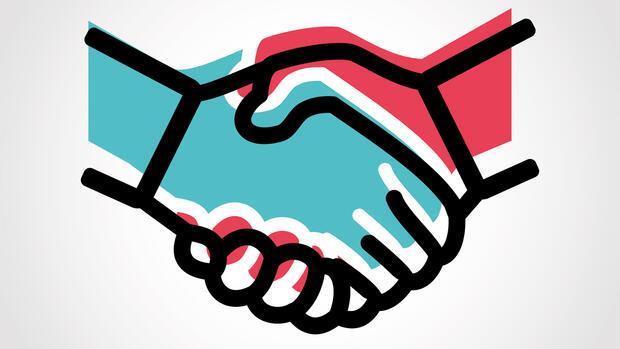 Erfolgreich verhandeln: Händeschütteln fördert die Kooperation