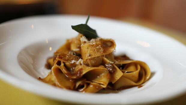 dish of pappardelle pasta with a wild boar Bolognese sauce at the Bistro Don Giovanni Quelle: AP