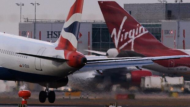 Fugzeuge von British Airways und Virgin Atlantic am Heathrow airport. Quelle: AFP