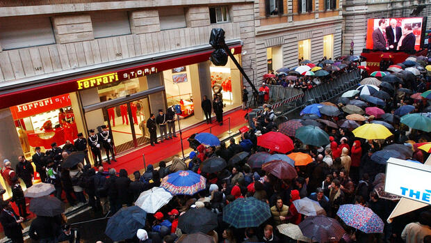 Ferrari Formula One team manager Jean Todt, at right on video screen at far right, is seen during the unveiling of the new Ferrari store in Rome's shopping district Via Tomacelli Quelle: AP