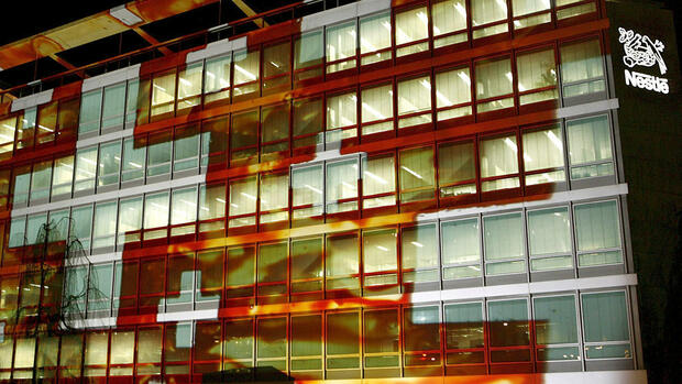The Swiss flag is projected on the international headquarters of Nestle, Quelle: dpa