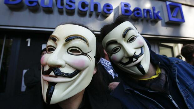 Demonstranten mit Guy-Fawkes-Masken in Frankfurt. Quelle: Reuters